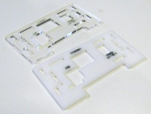 Laser cut acrylic parts with colored etching
